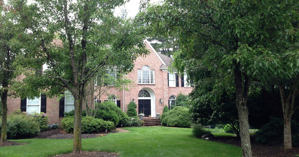 STUNNING Home on 1 acre wooded lot