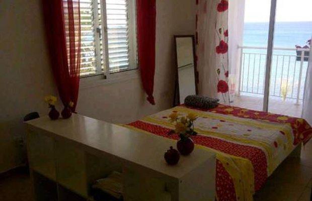 фото Akroyiali Beach Houses 673791411