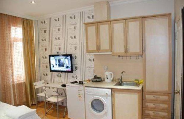 фото Taksim 9 Suites Apartments 677268106