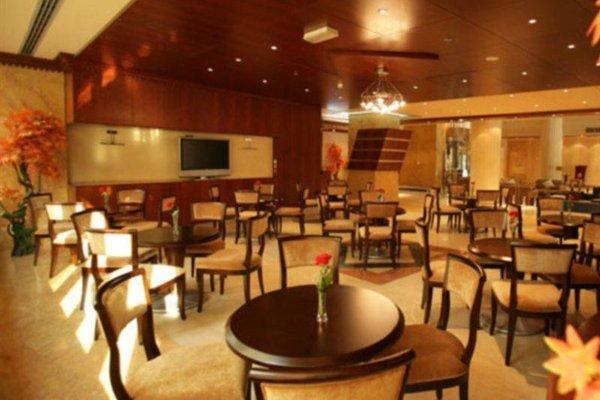 Al Manar Grand Hotel Apartment (ех. Belvedere Court Hotel Apartments) - фото 14