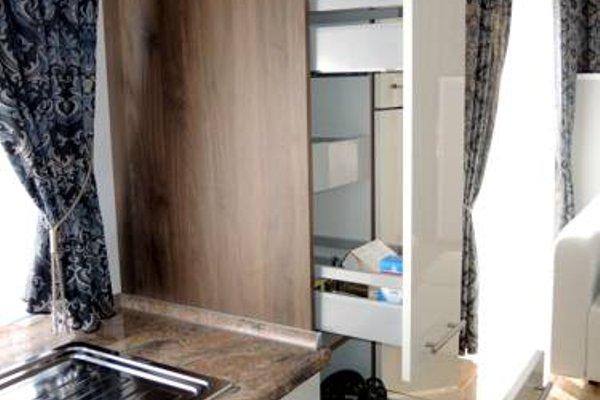 Merkel Villa Apartamente - фото 12