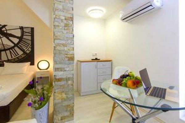 Penthouse Suites Apartments - фото 15