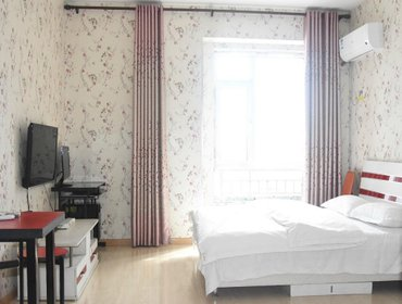 Апартаменты Harbin Mango Holiday Apartment