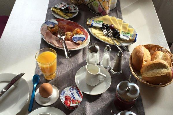 Cafe & Pension Am Brunnen - фото 9
