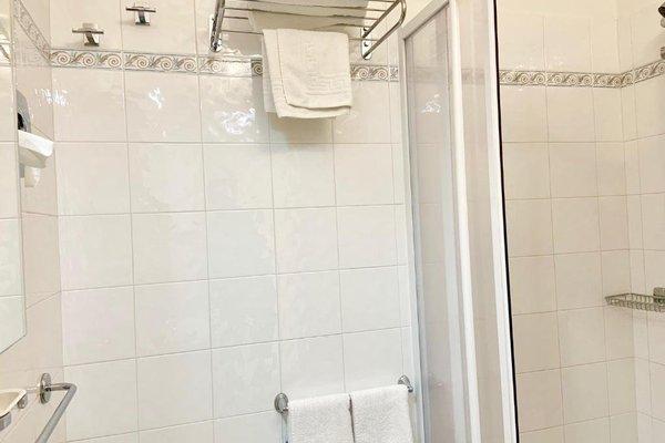 Suites Marilia Apartments - фото 11