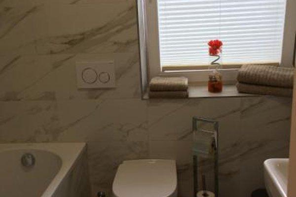 Design Apartment mit Terrasse - фото 19