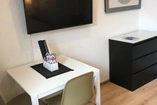 Design Apartment mit Terrasse - фото 21
