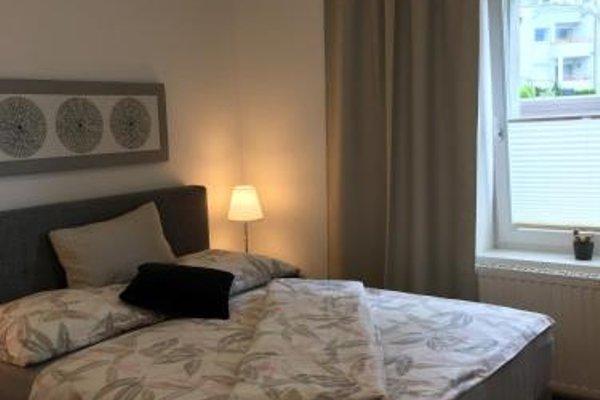 Design Apartment mit Terrasse - фото 22