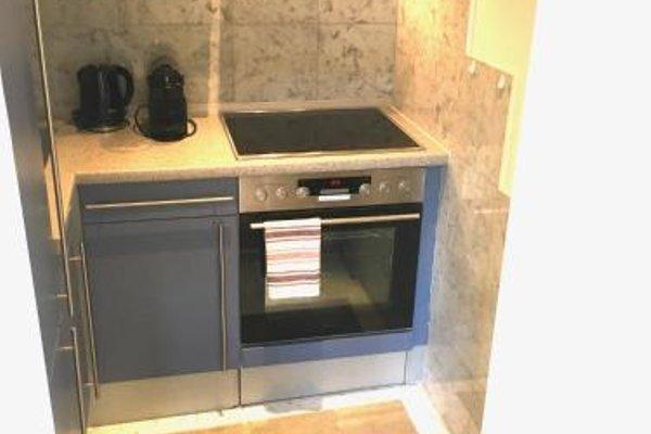 Design Apartment mit Terrasse - фото 23