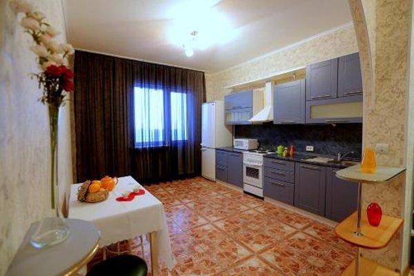 Surgut Apartments Apartments on Tumenskiy Tract 2 Aura - фото 10