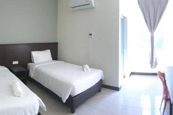 Kelibang Comfort Inn - 10
