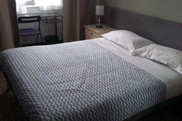 Check-Inn Rooms 19 - фото 22