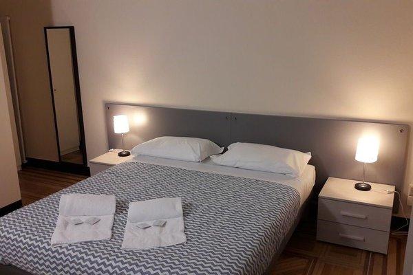 Check-Inn Rooms 19 - фото 4