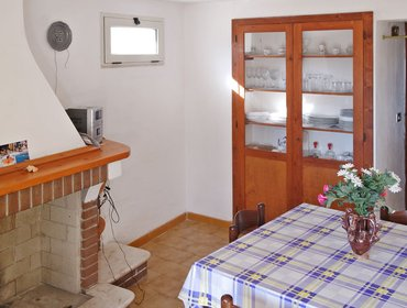 Апартаменты Bright apartment in an enchanting Sardinian village, w/ terrace & BBQ, 5-minute walk from the beach