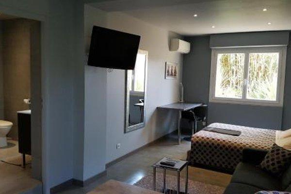 Appartements Le Clos des Bambous - фото 14
