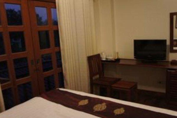 Manorom Boutique Hotel - 4
