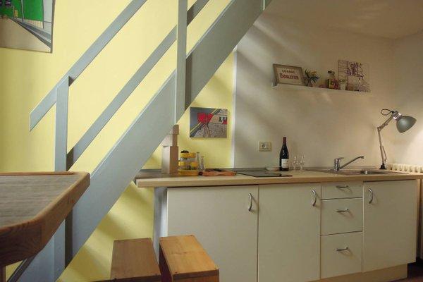 V12 Design Apartments - фото 16