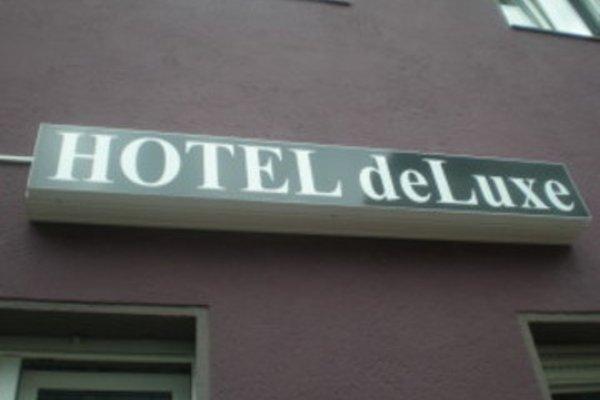 DELUXE - 6