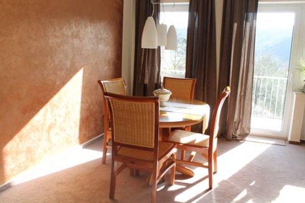 Haus Flora - Ferienwohnungen - 13