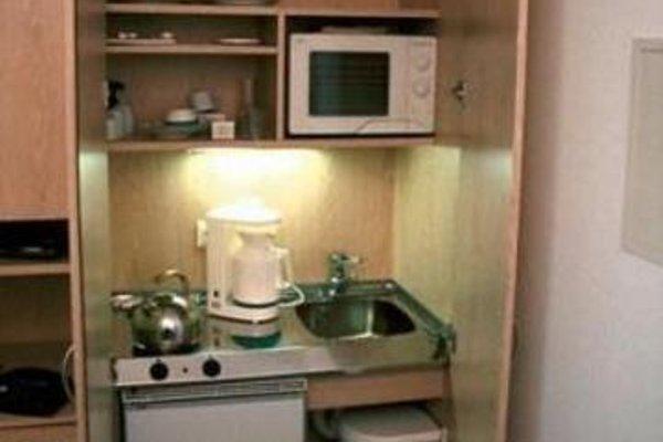 Residenz 2000 Aparthotel - 11