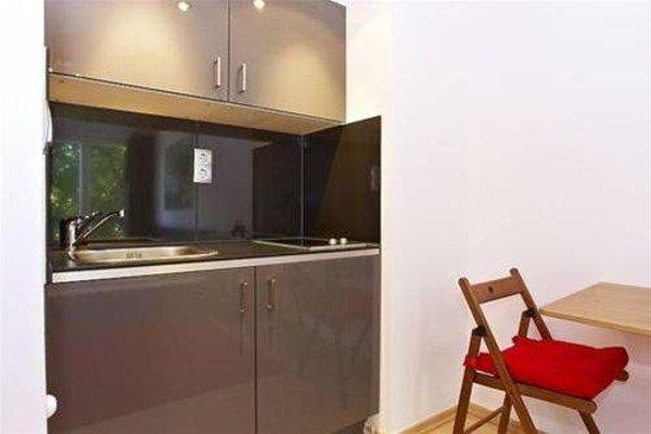 Q Damm Apartments - фото 11
