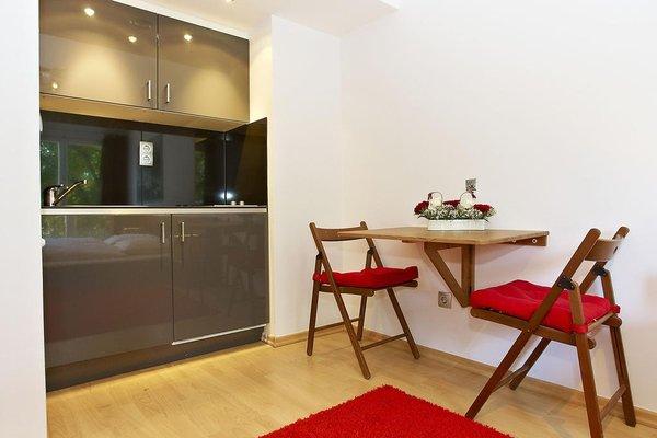 Q Damm Apartments - фото 12
