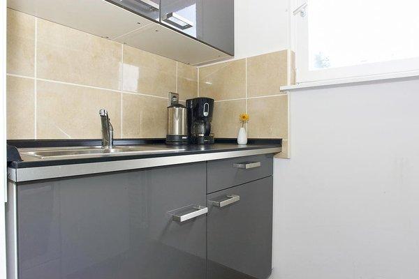 Q Damm Apartments - фото 13