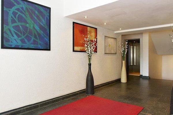Q Damm Apartments - фото 14