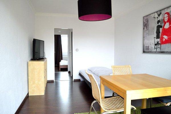 Q Damm Apartments - фото 4