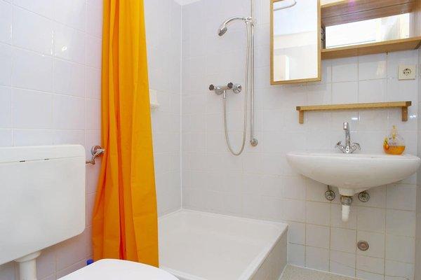 Q Damm Apartments - фото 8