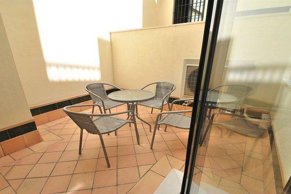 Apartamentos Living Sevilla Centro Maestranza - фото 17