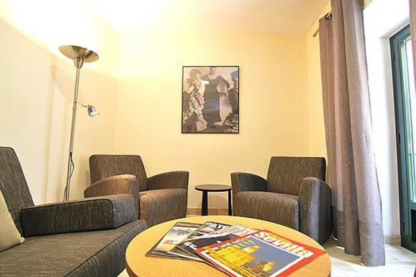Apartamentos Living Sevilla Centro Maestranza - фото 7
