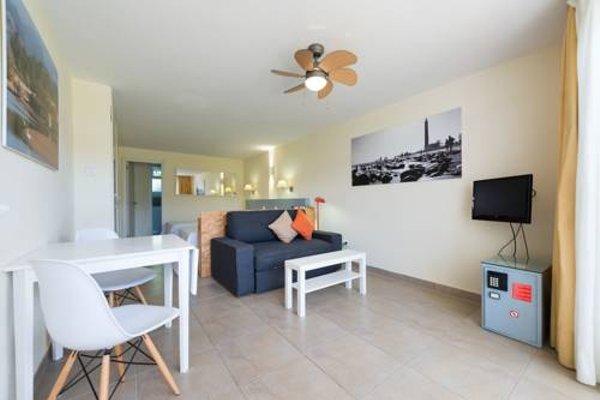 Apartamentos El Capricho - фото 10