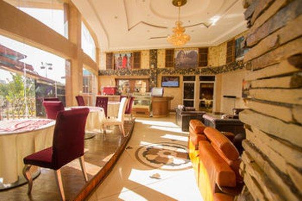 Aturukan Hotel - фото 10
