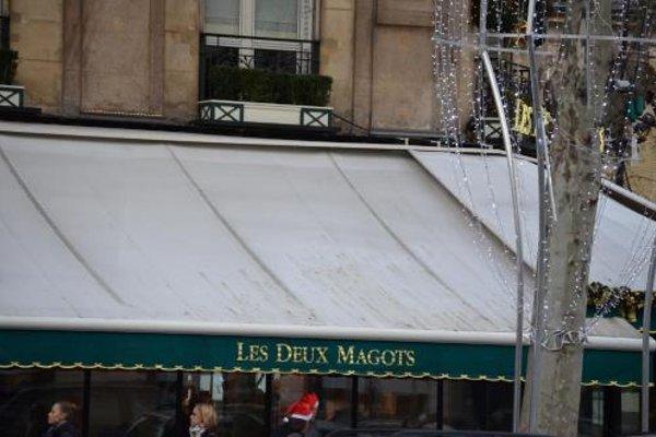 Saint Germain des Pres Apartment - фото 21