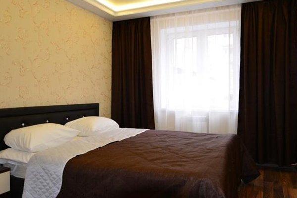 Отель Номера - фото 4