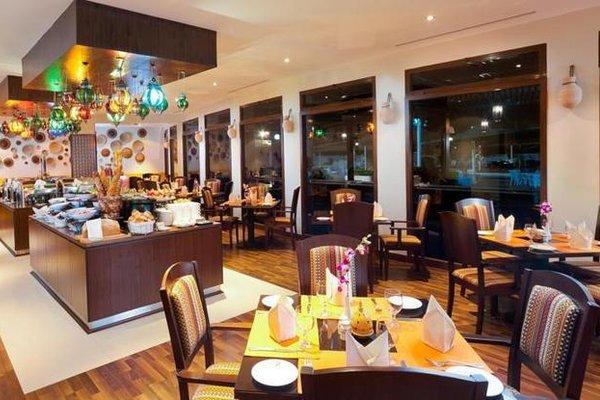 Al Falaj Hotel - фото 9