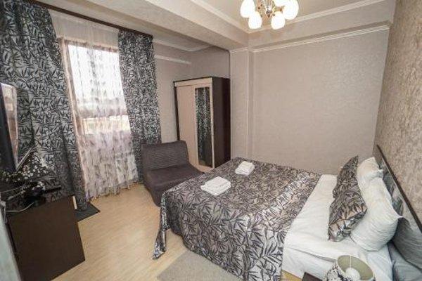 Апартаменты на Тюльпанов - фото 45