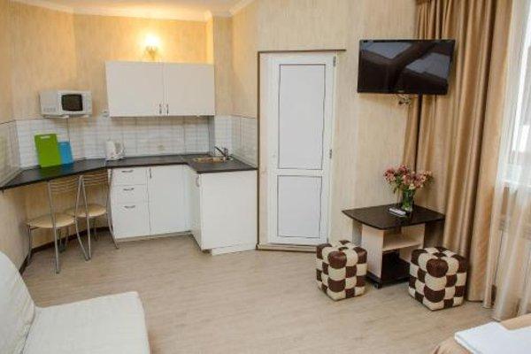 Апартаменты на Тюльпанов - фото 11