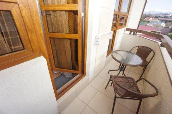 Апартаменты на Тюльпанов - фото 4