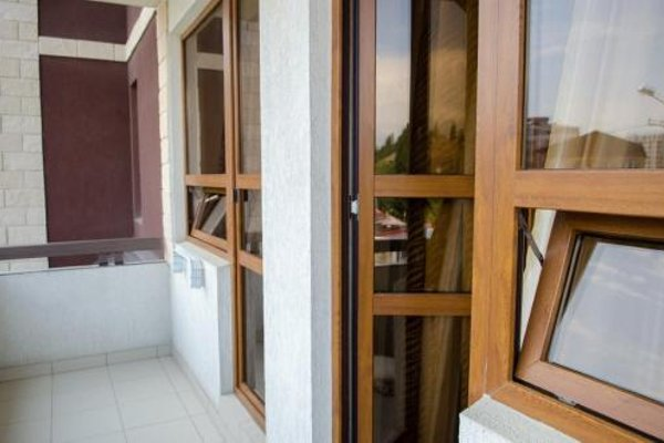 Апартаменты на Тюльпанов - фото 6