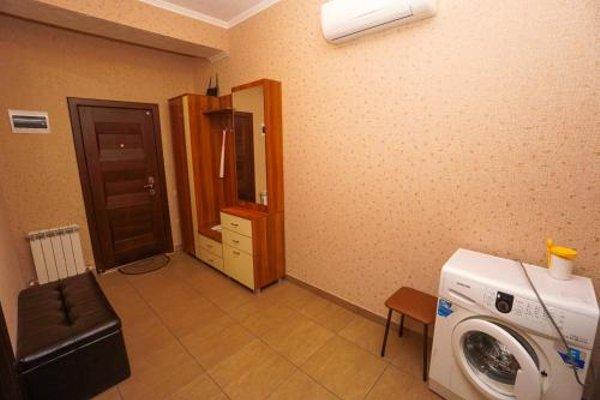 Апартаменты на Тюльпанов - фото 9