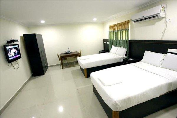 NGH Transit Hotel - фото 9