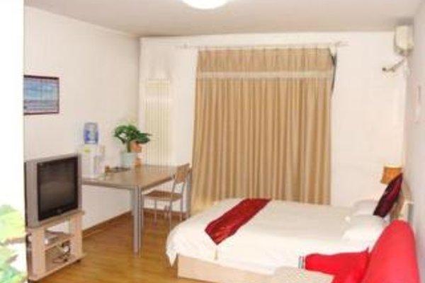 Sun Service Apartment Huamao - фото 11