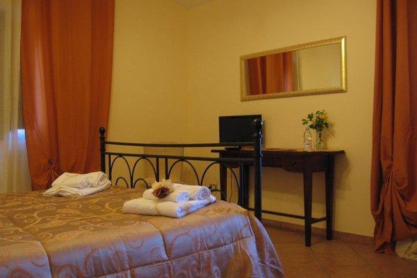 Этот семейный отель типа «постель и завтрак» - фото 11