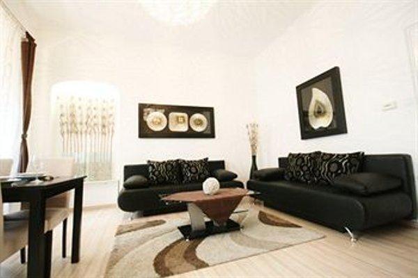 City Center Luxury Apartments - фото 9