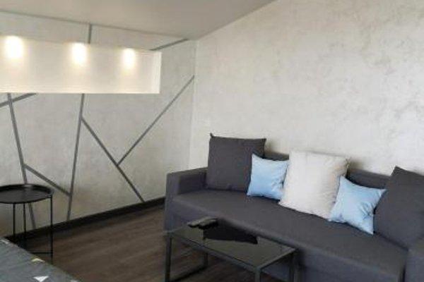 Apartments 4 on Arzhanovoy - фото 11