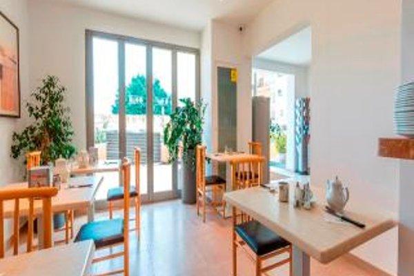 Huli Hotel & Apartments - 12