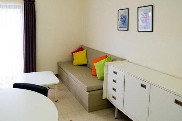 Huli Hotel & Apartments - 4