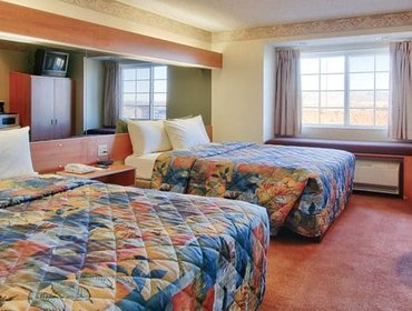 Апартаменты Western Skies Inn & Suites